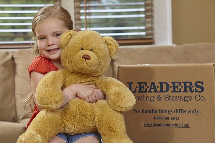 Girl moving with teddy