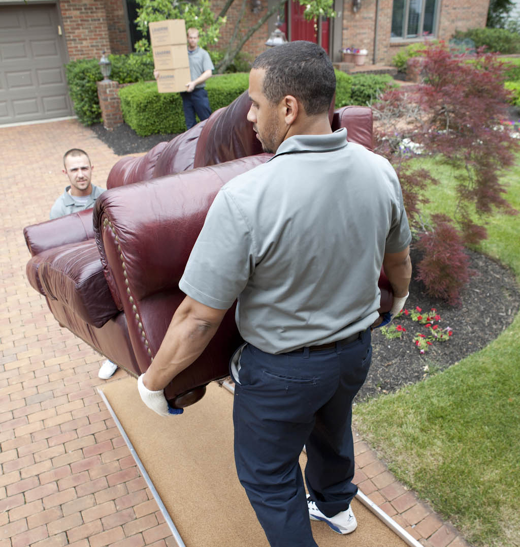 Movers loading couch into truck