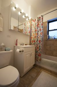 Bathroom with shower curtain and toiletries